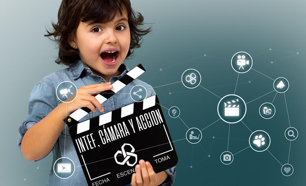 Niño con claqueta de cine. Intef, cámara y acción